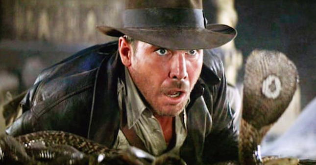 Harrison Ford as Indiana Jones faces a cobra
