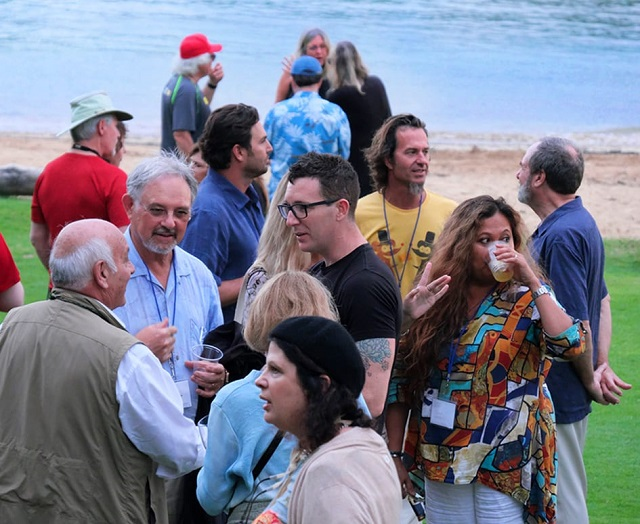 Kauai Conf-Participants and faculty mingling on the beach