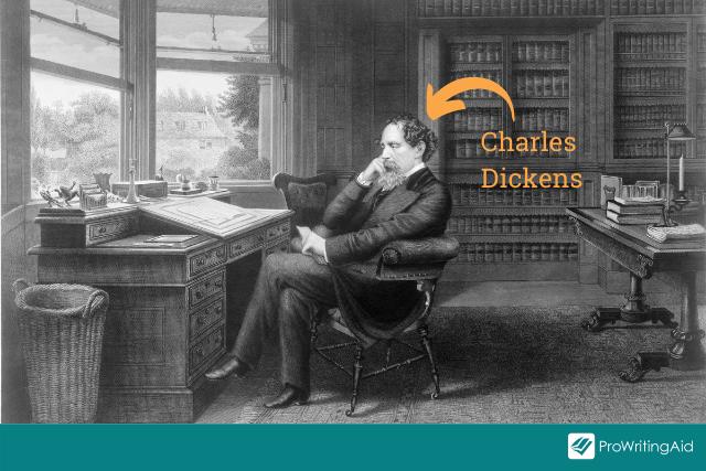 Charles Dickens sat at his writing desk