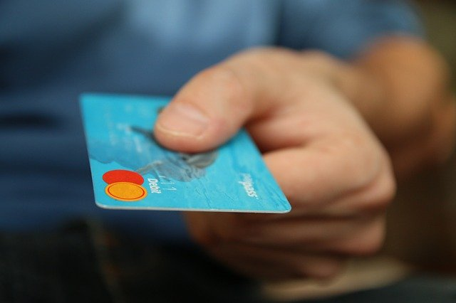 close up of someone holding a bank card