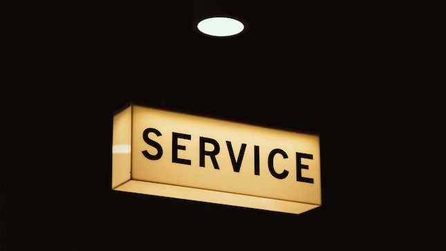 lighted sign reading Service