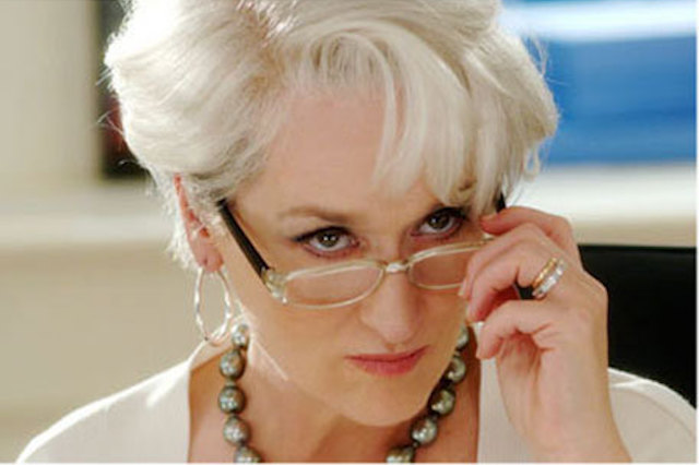 Miranda Priestly, Meryl Streep, glances over glasses from The Devil Wears Prada