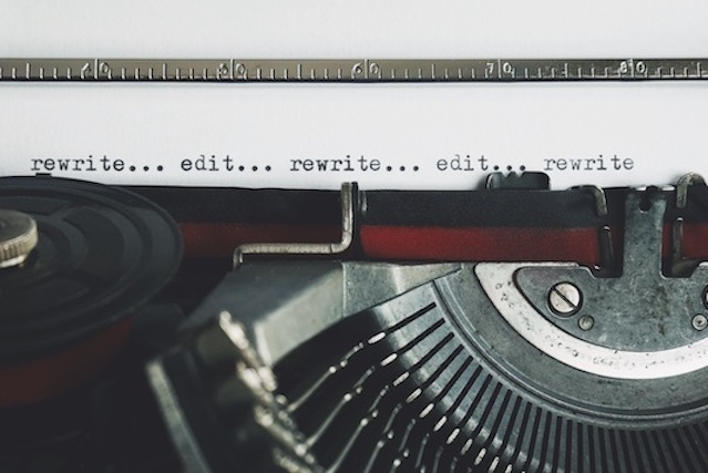 Typewriter page reading: edit...rewrite...edit...rewrite