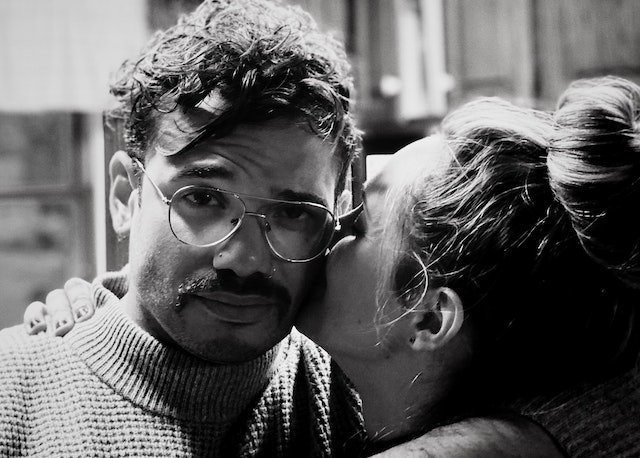 woman kissing man's cheek