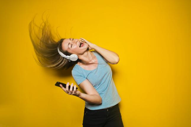 Woman dancing to music