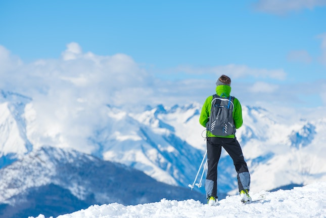 cross-country skier at mountain top
