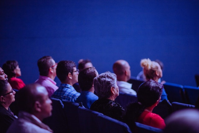 audience watching a cinema screen