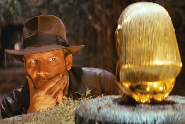 Harrison Ford studies artifact in opening scene of Raiders of the Lost Ark