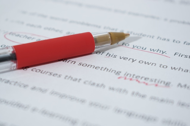 red pen and manuscript with edit marks
