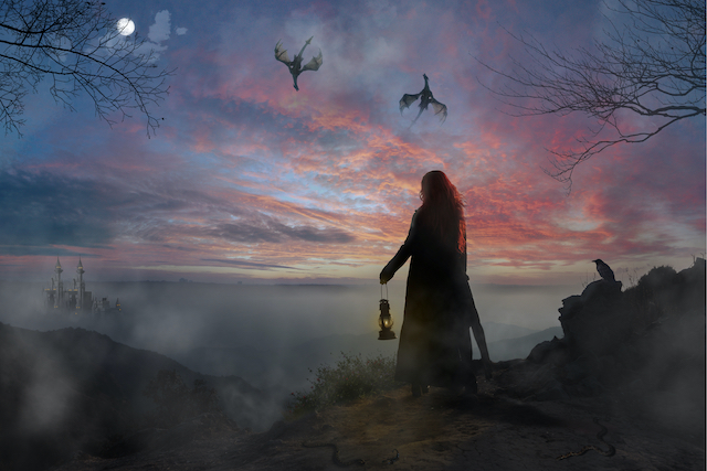 woman stands over a vast landscape, dragons circle in the sky
