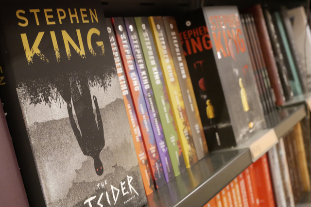 stephen king books on a shelf, spines out