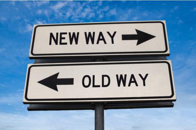 "sign pointing right to ""New Way"", and left to ""Old Way"""