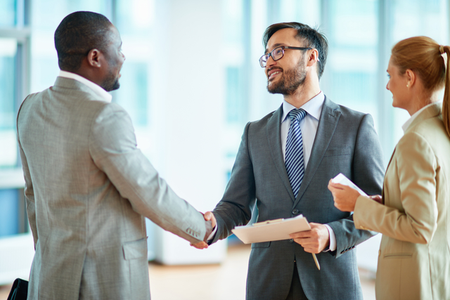 two men shake hands on a deal