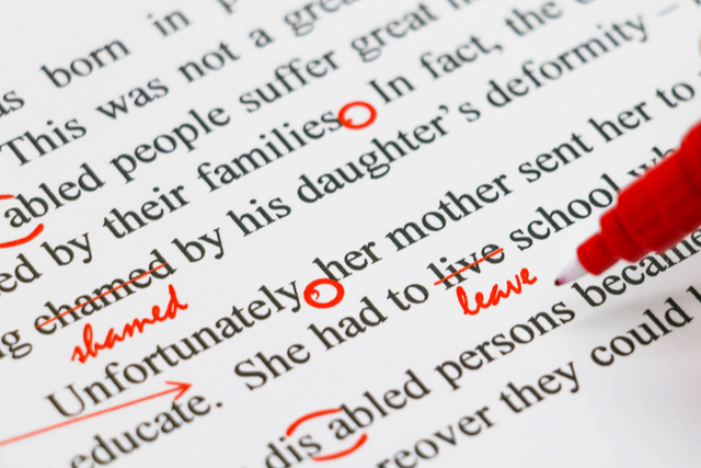 red pan marking up typed writing