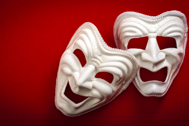 theatrical masks on a red background