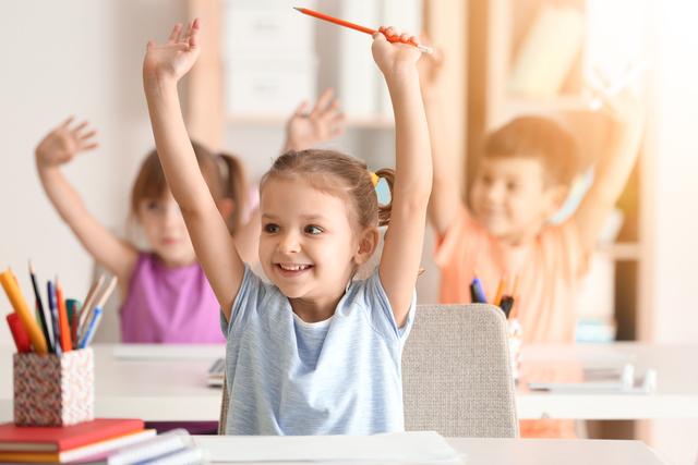 ChildrenWavingInClassroom